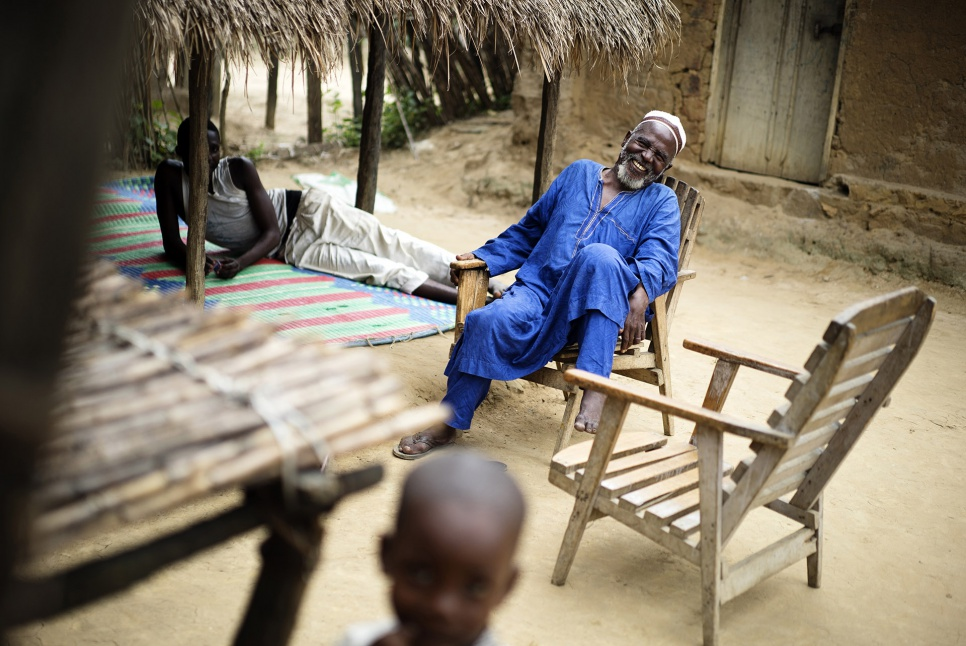 Imam Moussa Bawa, 72, laughs at his home in Zongo, DRC. He works to promote peace and reconciliation among refugees in the area.