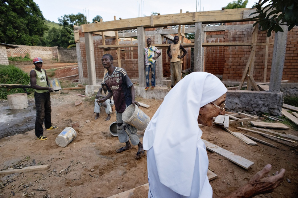 Sister Maria Concetta, 80, checks progress at the UNHCR-funded nutrition centre being constructed at the hospital where she works in Zongo, DRC.