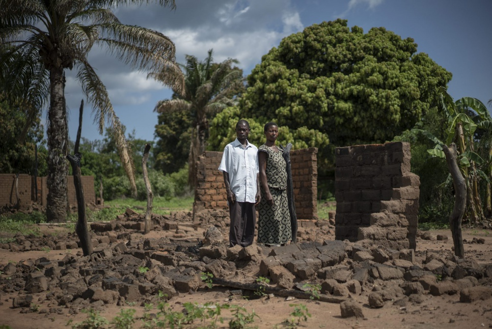 Pastor Mokoyo Jean and his wife, Wilambwe Antoinette, stand amid the ruins of their home in Kasonsa village, where hundreds of houses were burned in July during intercommunal clashes.