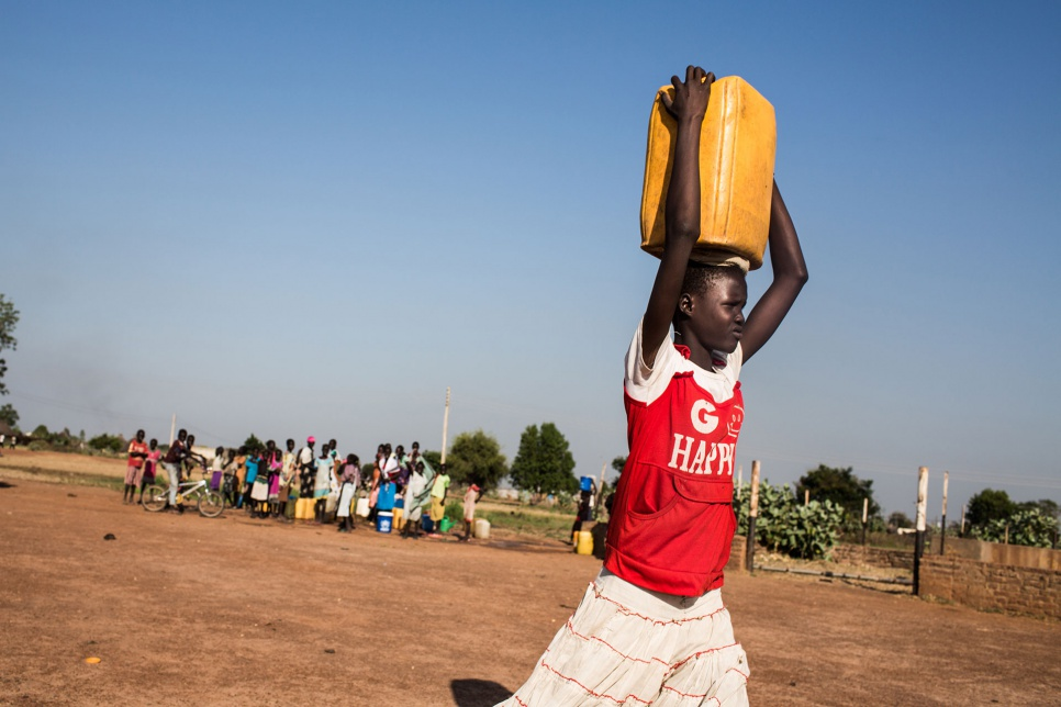 "Up to three times a day, Lina walks 25 minutes to the nearest water point to refill her jerrycan. ""None of my brothers and sisters is big enough to help me,"" she says."