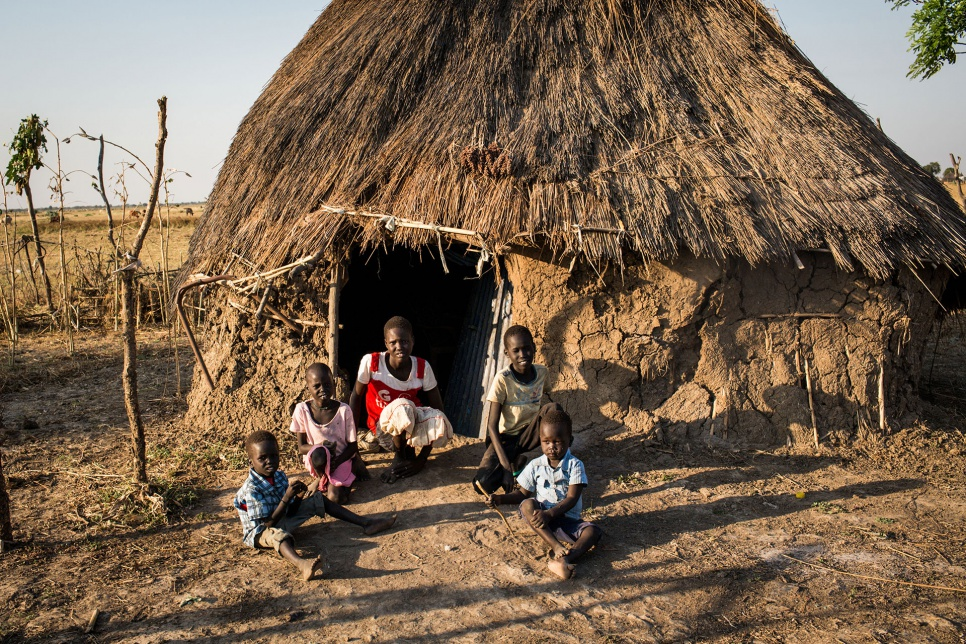 "Lina and her siblings sit by their temporary accommodation in Pariang, South Sudan. ""We are alone here really,"" she says."