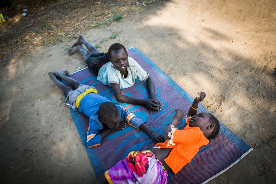 Adut's three youngest siblings play outside their temporary home in Bor, South Sudan.