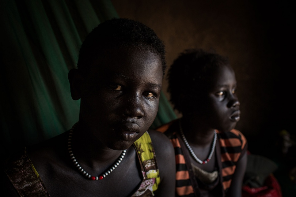 "Deborah (left) and Amol are living on their own in Bor, South Sudan. ""Things were okay. They were normal. Then… I saw the gunmen killing people and of course we had to run."""