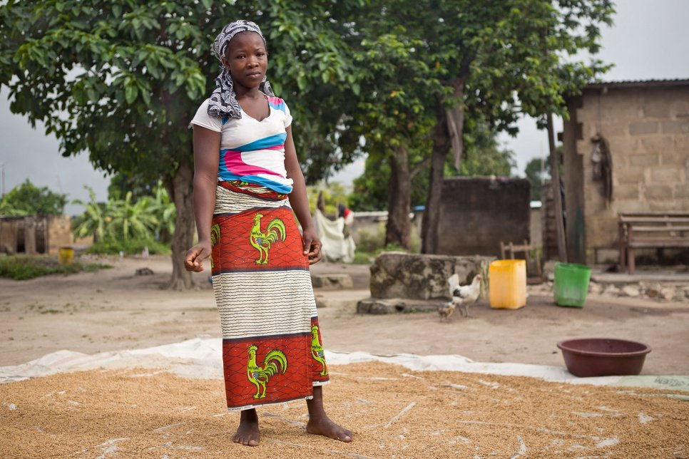 Rakiata's daughter, Lisette, 20, prepares millet for sale in Côte d'Ivoire. Lacking proof of her birth there, or of her ancestral ties to Burkina Faso, she is at risk of statelessness.