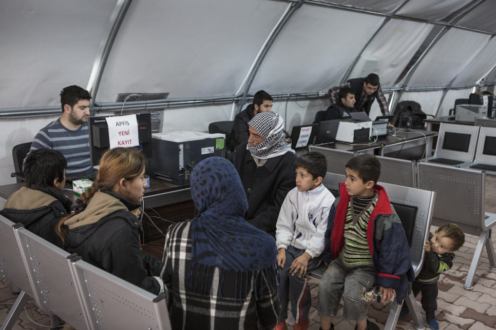 After hours of driving and a week in limbo, Wazzam, Ayesha and their six children register and are assigned a tent at Suruc camp in Turkey.