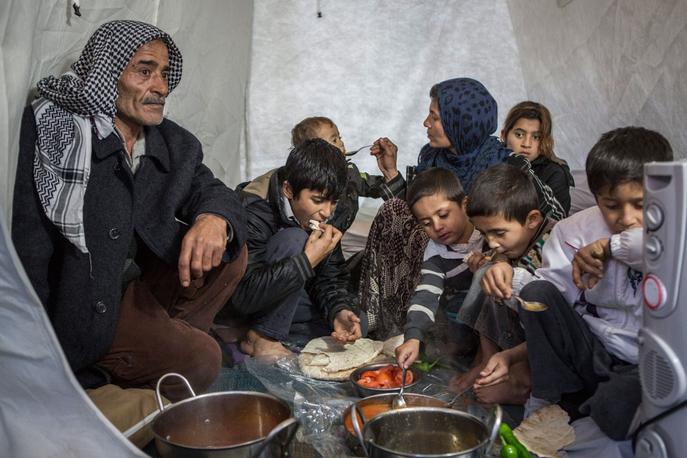 Ayesha says she hopes to one day return to Syria, but for now her family has nowhere else to go. Here the family finally rest and have some warm food at the end of a long day.