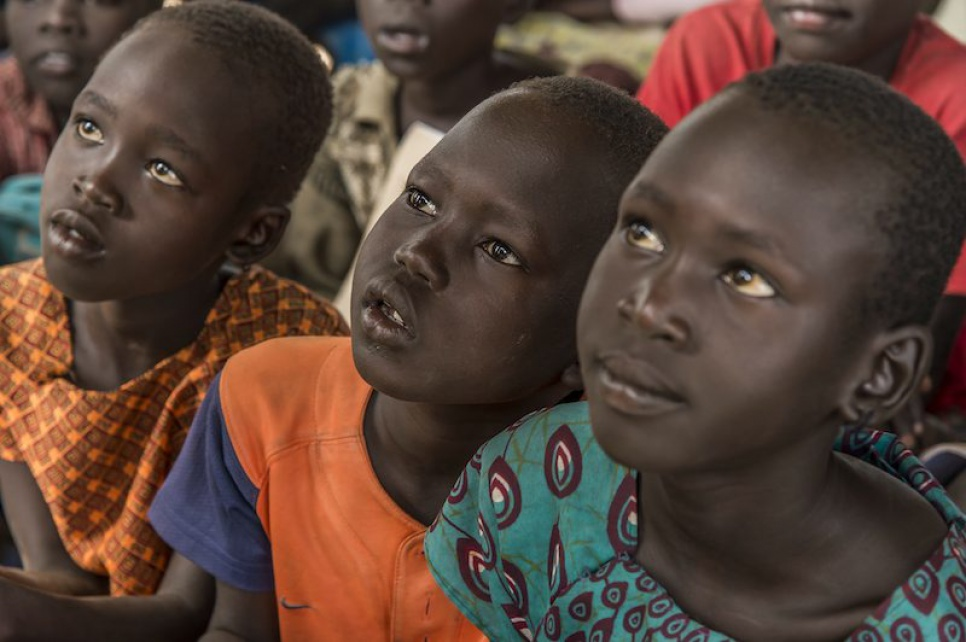 Refugee children from South Sudan pay close attention at Alaak's school in Nyumanzi refugee settlement.