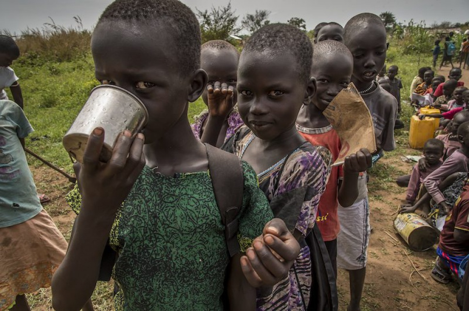 Alaak's students gulp down the water from a nearby hand pump at Uganda's Nyumanzi refugee settlement.