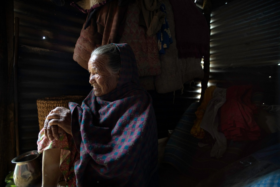 Antari Maya Jimba rests inside the shelter made of salvaged corrugated iron roofing that her family erected a day earlier in Jhankridanda village, in Nepal's Lalitpur District.