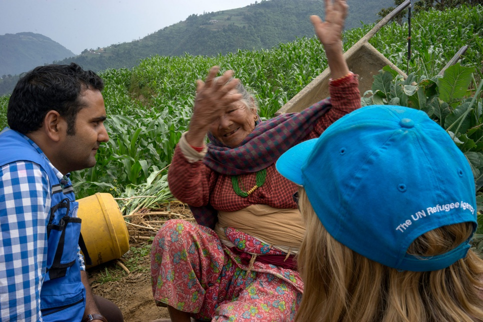 Antari Maya Jimba describes the April earthquake to aid workers who have come to the village of Jhankridanda, in the Lalitpur District of central Nepal.