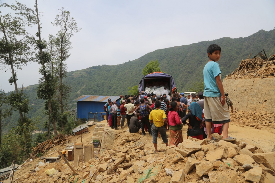 Survivors of the April earthquake collect UNHCR tarps, buckets, soap, towels and toothbrushes in Jhankridanda village, in Lalitpur District, Nepal.