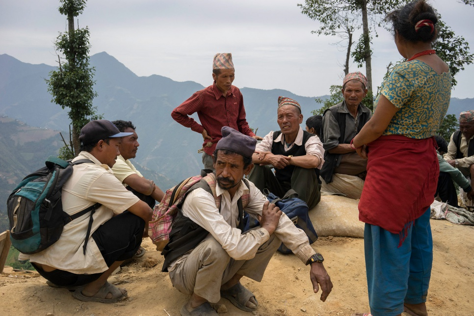 Survivors await the arrival of relief supplies in Jhankridanda village, in Nepal's Lalitpur District.