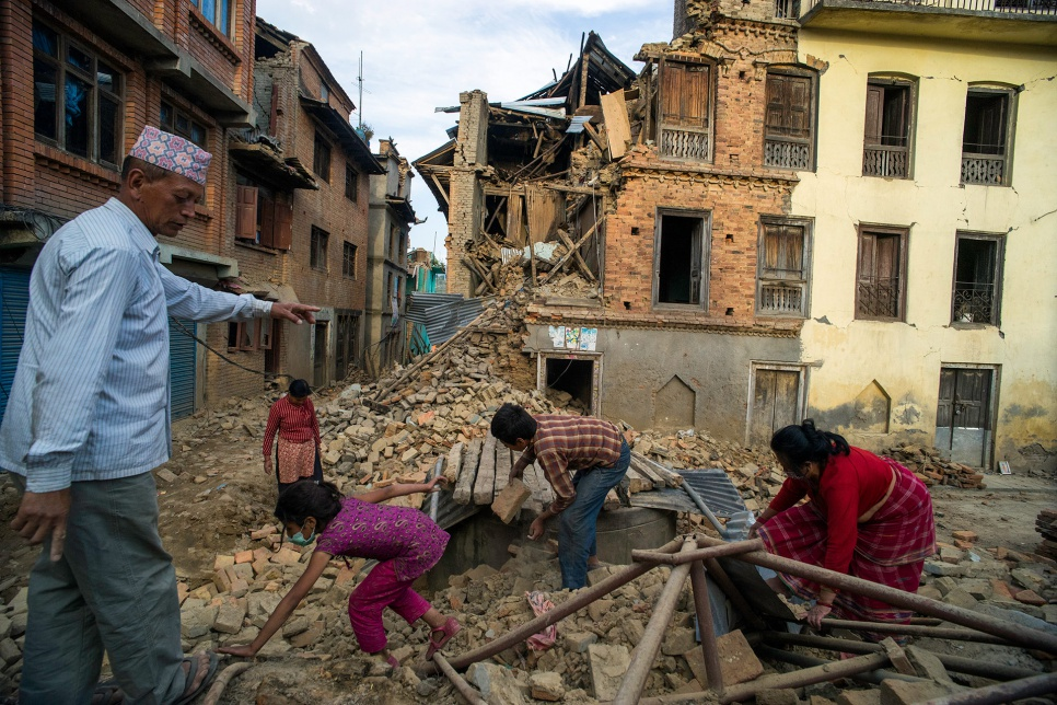 Bhupendra Man Shrestha, 51, and his family excavate the ruins of their collapsed home in Sankhu village, in Nepal's Kathmandu Valley.