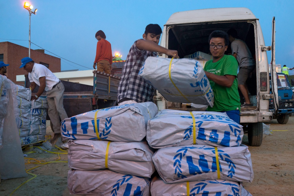 At the airport in Kathmandu, local volunteers unload UNHCR relief supplies before they are distributed to communities affected by the April earthquake.