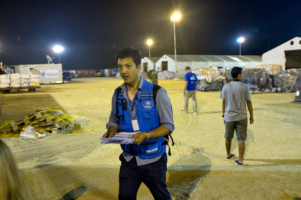 Deepesh Shrestha, a UNHCR communications officer, works into the night at Tribhuvan International Airport in Kathmandu, Nepal.