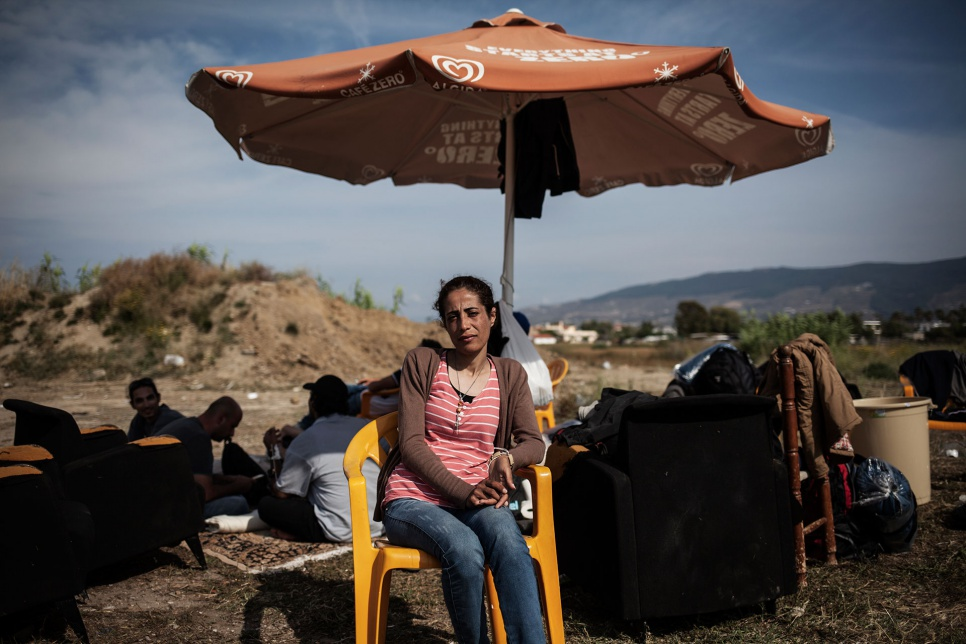 Nasreen sits outside the defunct Captain Elias Hotel in Kos, Greece, where she and other Syrian refugees have found temporary shelter.