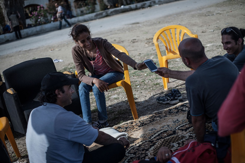 Nasreen chats with friends outside the defunct Captain Elias Hotel in Kos, Greece, where some Syrian refugees have found temporary shelter.