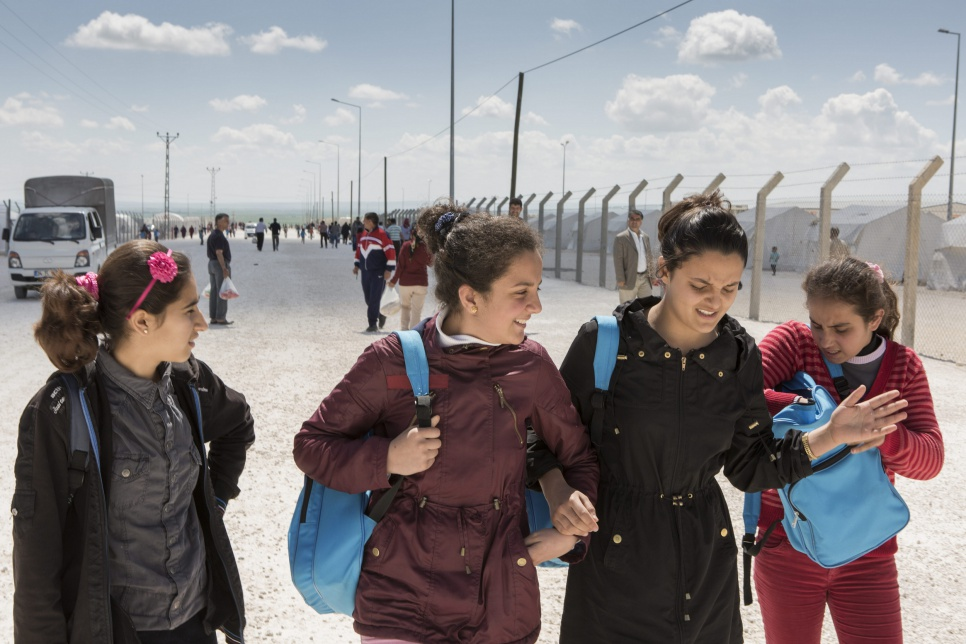 Ivra (second from left) walks with friends on the way back to her family's tent after school in Suruç camp.