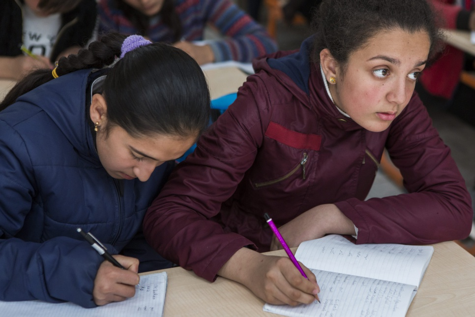 Ivra takes notes during a class in Suruç camp, Turkey.