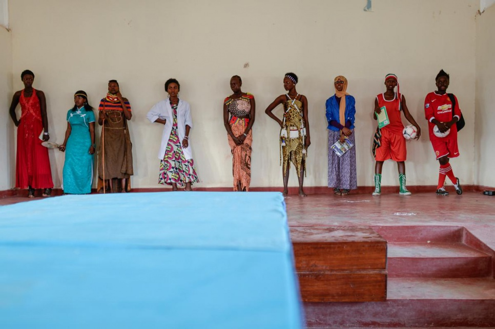 It's not all study at school. Esther Nyakong (far right) and eight other students perform as models during recreation time.