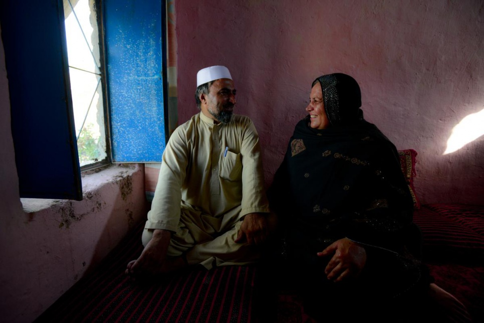 "Asifi at home with her husband, Sher Muhammad. He has championed her work with refugees from the start: ""In the future I would like [the schools] to go beyond 8th grade,"" he says."