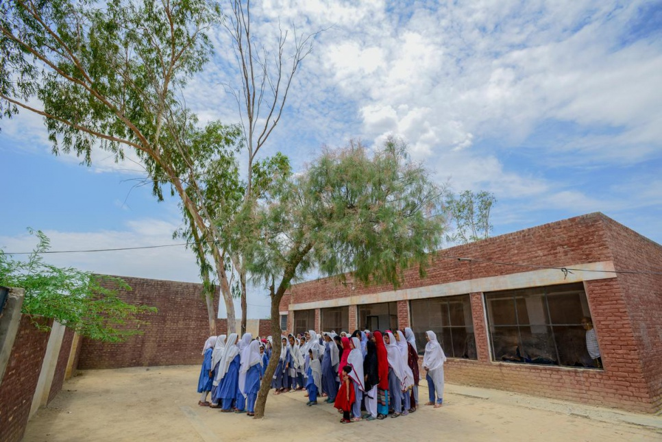 Young Afghan refugees and Pakistani girls attend assembly at Aqeela Asifi's school. Today 1,500 young people are enrolled in six schools throughout the refugee village.