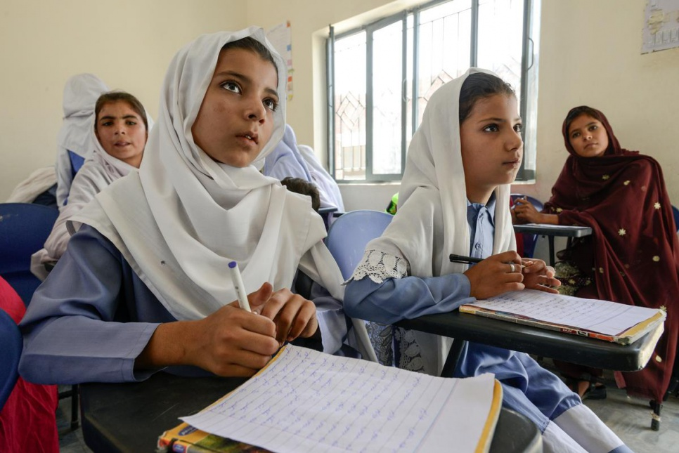 Nadia, 12, left, and Haseena, 9, study at Aqeela Asifi's girls school in Kot Chandana refugee village in Mianwali, Pakistan.