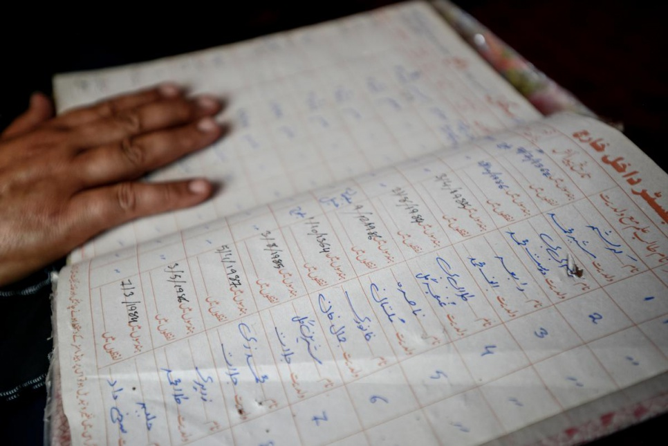 Over the past 20 years Aqeela Asifi has kept track of her students with an organized school register.