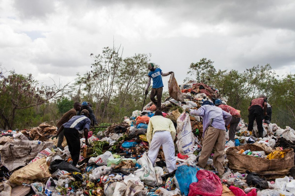 Dominicans of Haitian descent collect rubbish at the dump.