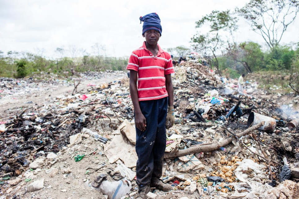 Like Joe, 13-year-old Adrian works at San Pedro de Macoris municipal dump during his summer vacations, looking for metal scraps.