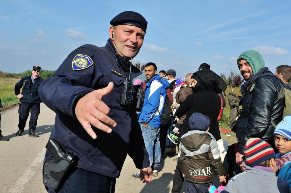 Police commander Zoran Markovic, 45, greets refugees arriving in Croatia after crossing the border from Serbia.
