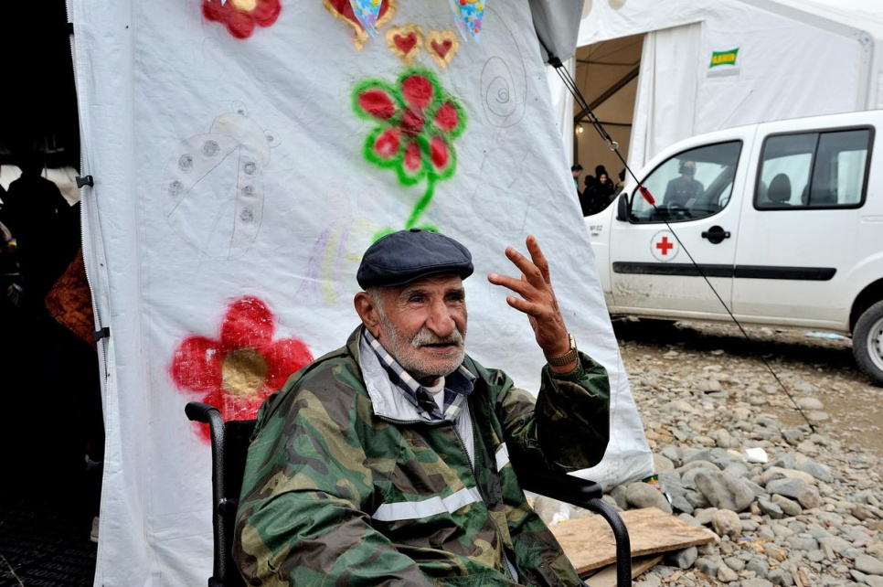 Ismail, an 80-year-old refugee from Syria, sits in his wheelchair outside a tent at Vinojug reception centre in the former Yugoslav Republic of Macedonia. He is waiting for the rest of his family, which includes 23 people spanning three generations. The family will receive food, clothing and medical help.