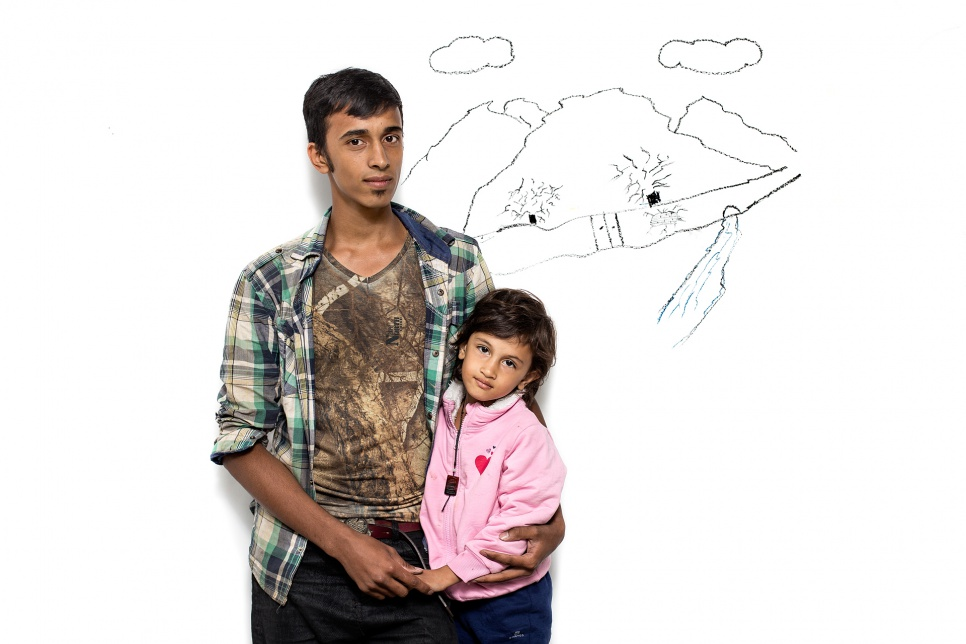 Ashkan and Setays, siblings from Afghanistan.<br><br>They drew their home, surrounded with a wall and a small crack where they escaped.