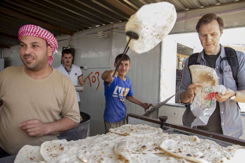 David Morrissey UNHCR High profile supporter buys bread from a bakery on Za'atri's Avenue des Champs Elysees