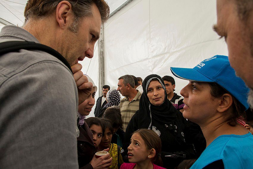 David Morrissey UNHCR High profile supporter meets and talks with Syrian refugees queuing up at the UNHCR registration offices in Amman, Jordan