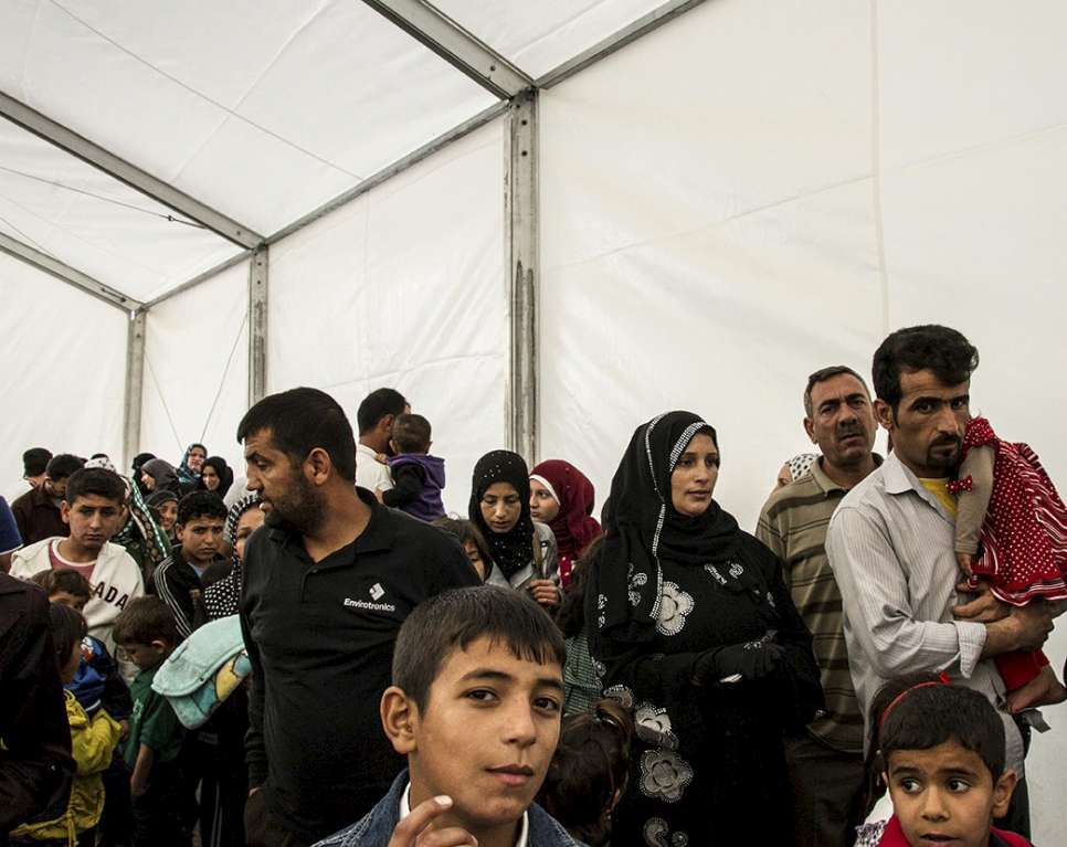 Syrian refugees queue up to be registered at the UNHCR registration offices in Amman, Jordan