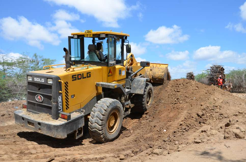 As part of camp cleaning exercise, a backhoe is filling a dumpsite and digging a new one in Dagahaley camp of Dadaab. UNHCR and its partner agencies have been carrying out soap distribution and hygiene promotion campaign in the five Dadaab camps.