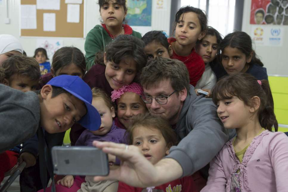 Jordan. UNHCR High Profile Supporter John Green meets children at the UNHCR funded Community centre in Azraq refugee camp