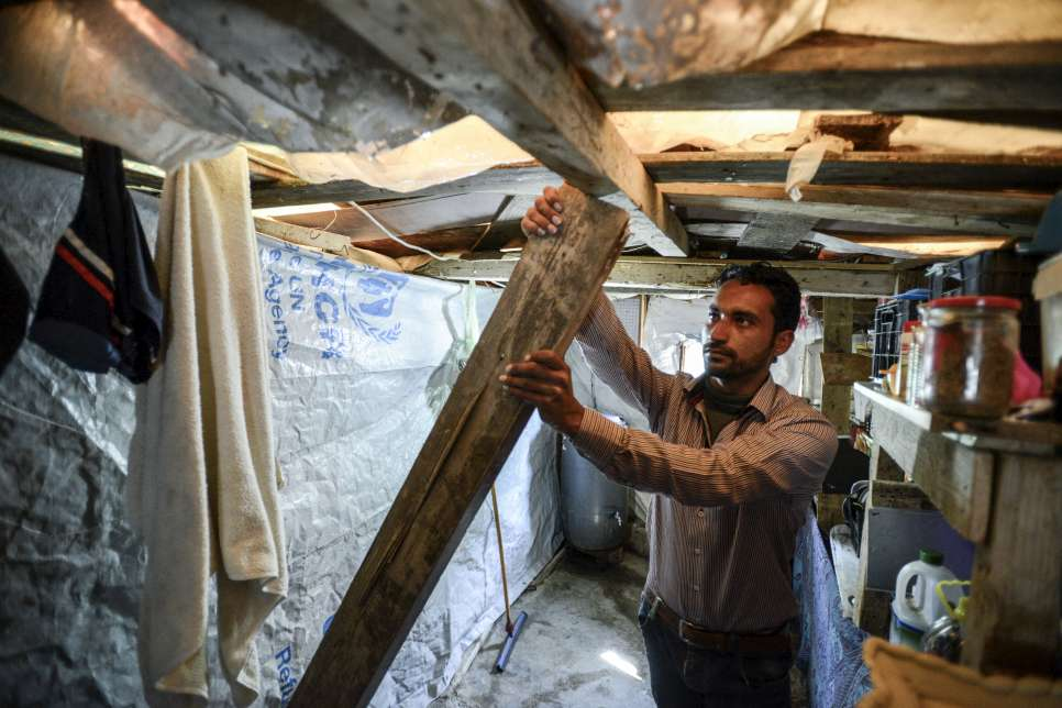 Hayel, who fled Syria with his young family, uses a wooden pole to support the kitchen roof in his makeshift shelter in Lebanon. It's so dangerous that he doesn't let the children in the kitchen.