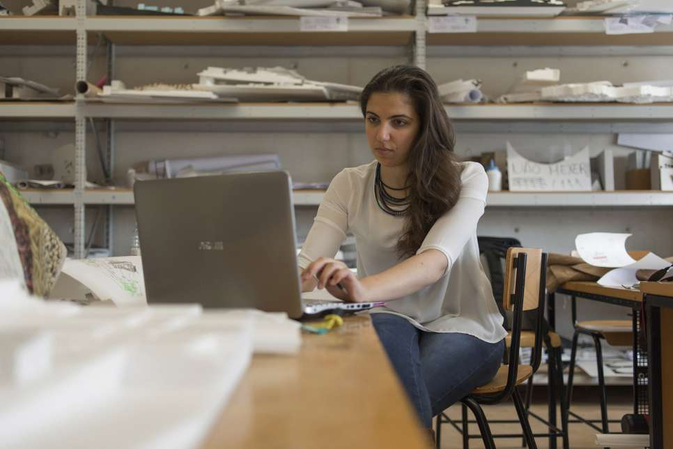 Alaa works on her latest architectural design at the University of Lisbon, where she is a third-year student thanks to a scholarship program for Syrians.
