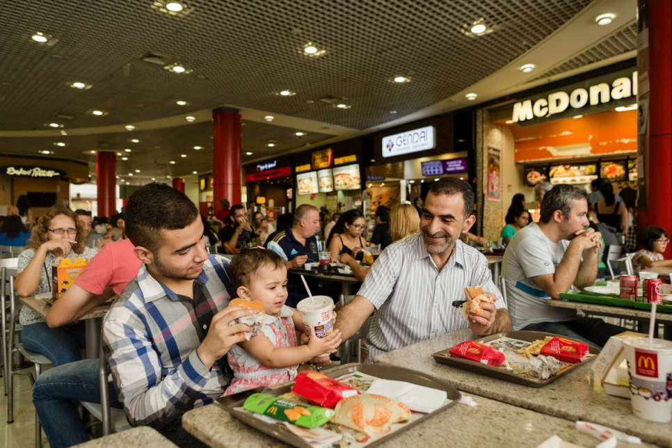 Khaled and his children enjoy a day out at a shopping mall in the Tatuape neighborhood of São Paulo, Brazil.