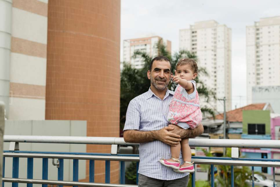 Khaled stands with one-year-old Yara during a Sunday afternoon trip to a shopping mall in the Tatuape neighborhood of São Paulo.
