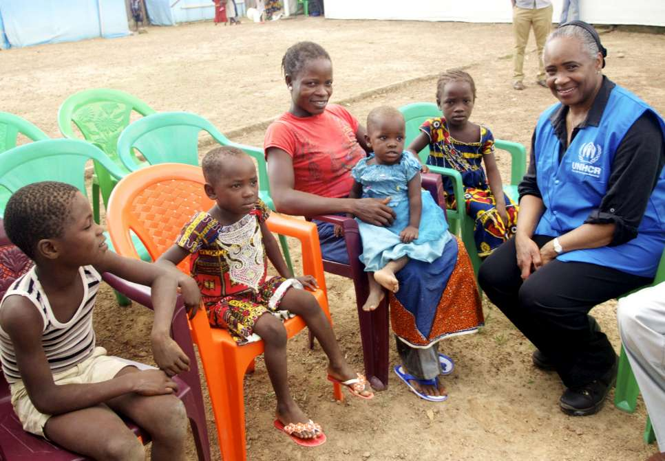 Goodwill Ambassador Barbara Hendricks talks to a mother and children in the transit camp on the border of Liberia, Cote D'Ivoire. July 2014.
