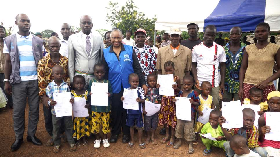 Standing with the villagers of Dronguine, Cote D'Ivoire. Their children had just been given their birth certificates. Without documents they would risk being Stateless. July 2014