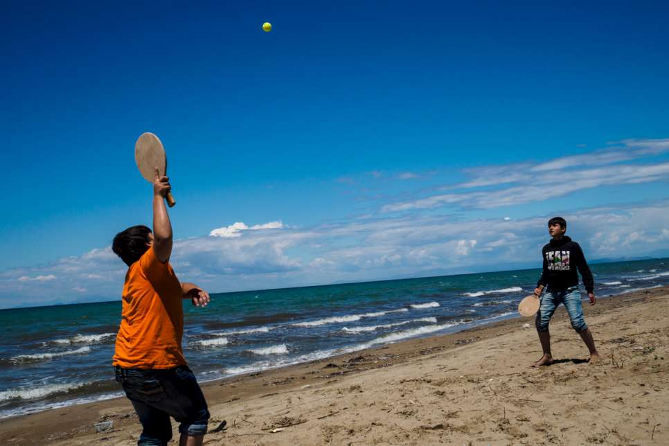 Two boys play a game on the beach at LM Village, in Greece's Peloponnese region.