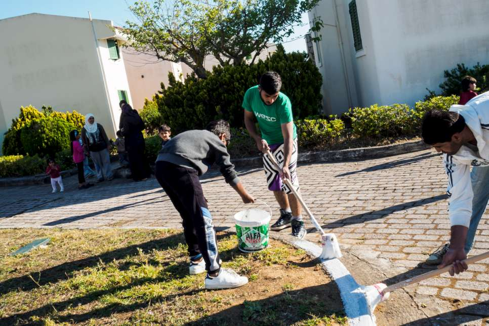 Refugees spruce up some of the public spaces in LM Village.