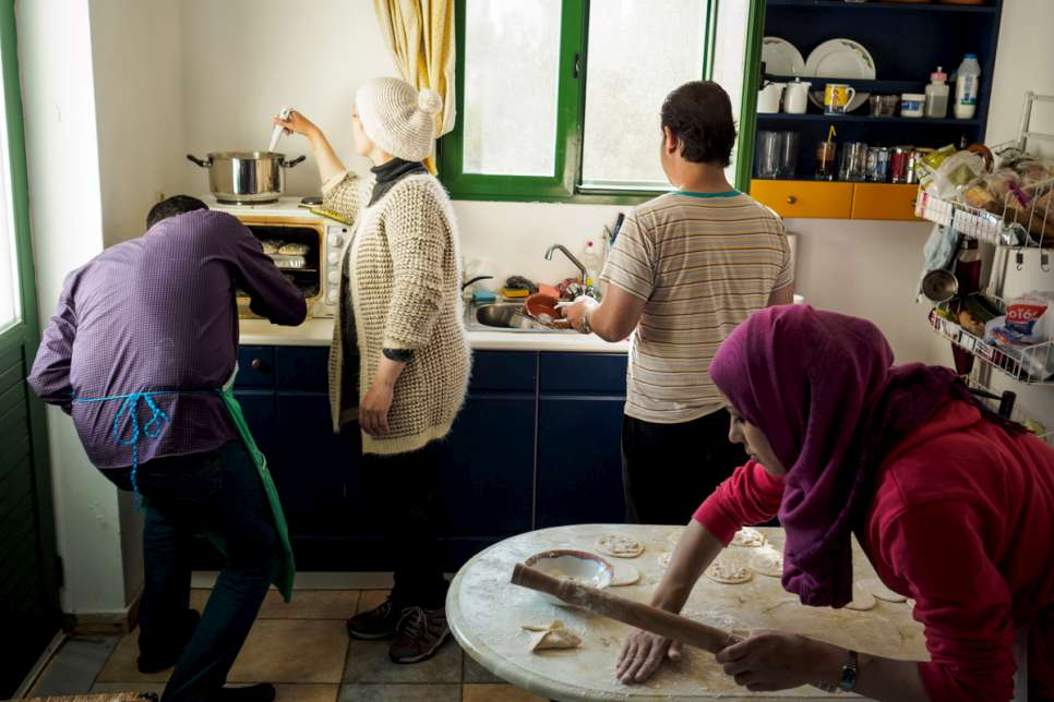 Tarek and Kindra prepare dinner with Mohammed and his wife, Marua.