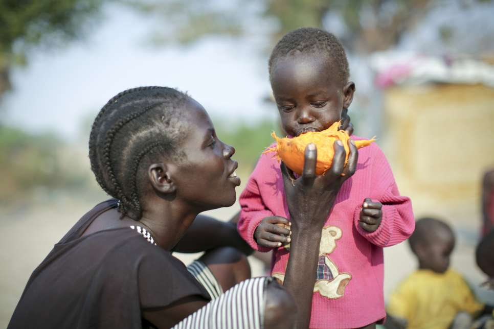 After seven days on the run, young Nyanchau, who is internally displaced, chews on the dry flesh of a palm nut in Rumbek, South Sudan.