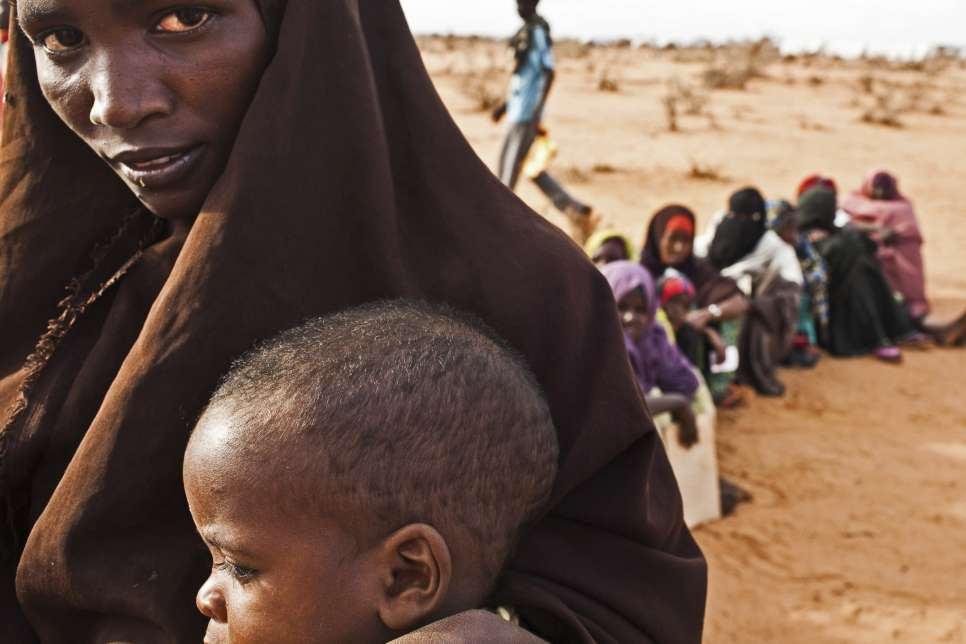Somali refugees wait in line at the reception centre in Ifo camp in Dadaab, Kenya.