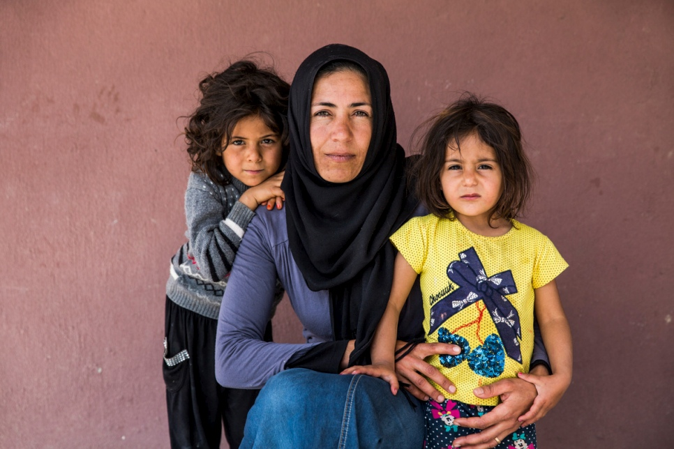 Juria, 31, pictured with her daughters Manal, 7, and Fatima, 3, in Torbali, Turkey.